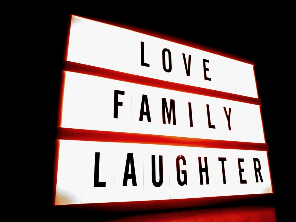 Love family laughter lettering sign